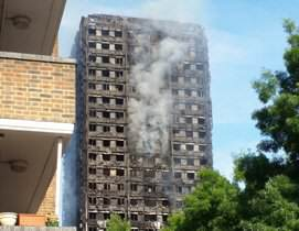 UK's Prime Minister orders public inquiry into tower block fire