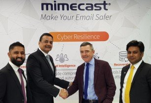 Spire Solutions Sanjeev Walia shakes hands with Mimecasts Jeff Ogden
